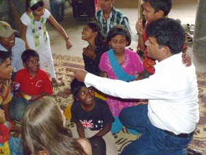 Picture of Satish playing with the kids