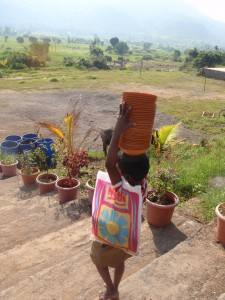 Picture of child carrying bowls