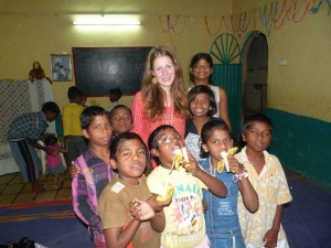 Picture of our volunteer and the children