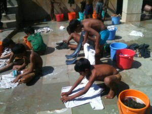 Picture of our boys washing their clothes