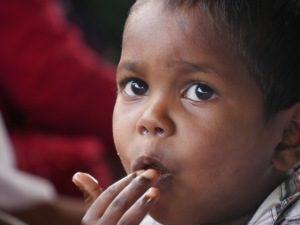 Samir eating gulab jamun