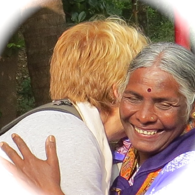 Indian lady hugging tourist
